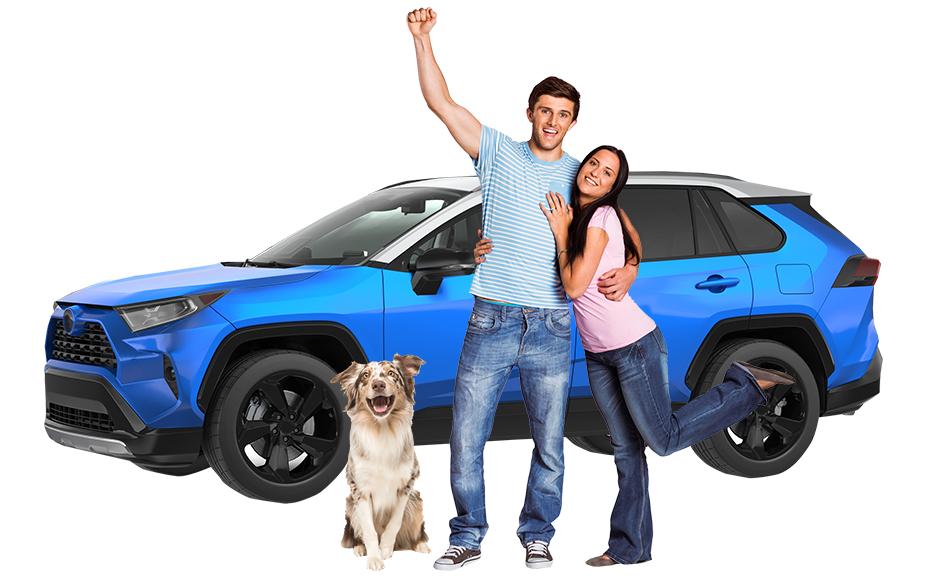 Happy couple standing in front of car with dog.