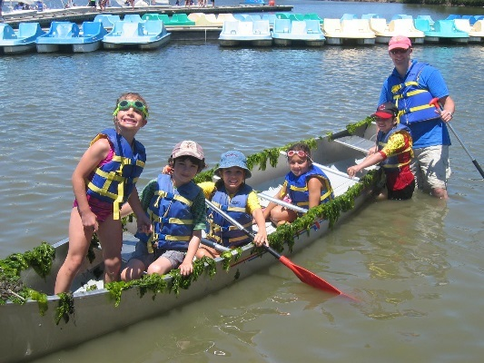 Campers Displaying a Customized Canoe