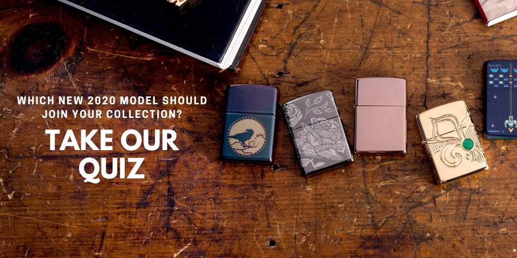 A variety of Zippo base models lie on a table.